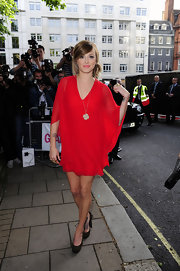 Fearne showed off a chiffon red dress, which was the perfect balance to her rock and roll studded heels.