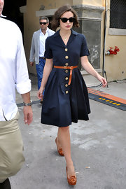 Keira paired her shirt dress with tan 'Evie' loafers that perfectly complemented her tan belt and gold buttons.