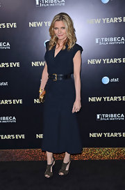 Michelle Pfeiffer donned a dark faux-wrap dress with a thick belt for the 'New Year's Eve' premiere.