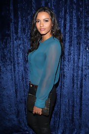 Jessica Lucas showed off her edgy side with a black studded clutch at the 'Super 8' DVD Party.