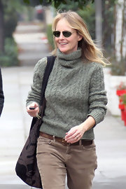 Helen Hunt looked cheerful wearing a pair of gold framed aviator sunglasses.