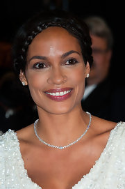 Rosario Dawson kept her red carpet look lovely and feminine with a braided updo.