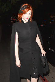 Christina Hendricks exuded confidence in a classic black cape.