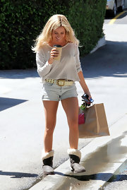Leave it to Ashley Tisdale to work a pair of Ugg boots and short shorts.