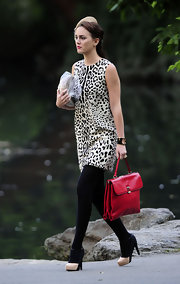 Leighton Meester looked ultra chic on the 'Gossip Girl' set in an animal-print frock. She added pep to her step with a pair of nude and black platform T-strap pumps.