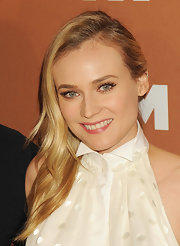 Diane Kruger chose a simple wavy style with a deep side part for her effortless red carpet look.