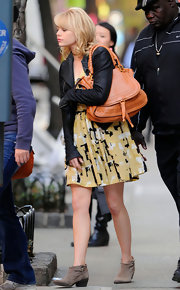 Emma Stone was spotted leaving the set of 'The Amazing Spiderman' carrying a large tan Marcie shoulder bag.