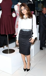 Eva Mendes chose a classic and elegant white blouse and black pencil skirt combo for the launch of her collection.