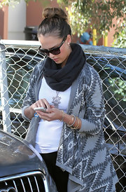 Jessica Alba bundled up in a knit scarf and Aztec cardigan while out and about in Santa Monica.