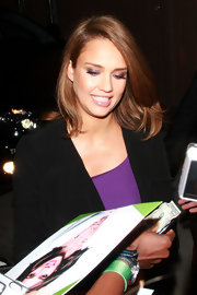 Glowing star Jessica Alba paired her purple frock with sleek and shiny locks for her appearance on 'Jimmy Kimmel Live.'