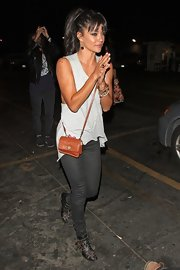 Perfect for a night out, Jessica Szohr rocked a classic tiny tan leather crossbody when she went to see The Kills in concert.