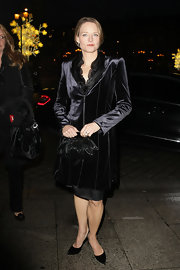 Jodie donned a velvet evening coat with her black ensemble for the Giorgio Armani fashion show.
