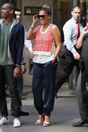 La La Anthony looked laid-back yet chic in dark blue harem pants and a print blouse while out and about in New York City.