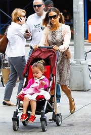 Sarah Jessica Parker was a chic momma in this python dress and cardigan.