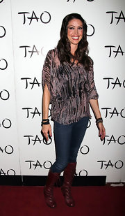 Shannon Elizabeth laced up a pair of oxblood leather boots before stepping onto the red carpet at Tao in Las Vegas.