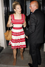 Sienna looked sweet out in London wearing a candy cane square-neck day dress.