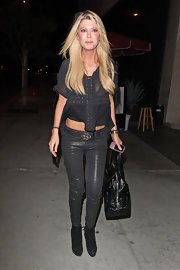Tara Reid went clubbing in a pair of metallic black skinny jeans and a sheer crop top.