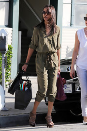 Zoe Saldana looked street chic in an olive tie-waist jumpsuit while out and about in LA. Platform sandals added umph to her sassy look.