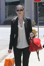 Michelle Trachtenberg showed off her leather tote bag while doing some shopping in Los Angeles.