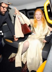 Vivienne Westwood complemented her outfit with a brown leather purse at the Fashion for Relief charity dinner.