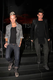 Sauli Koskinen looked casual and edgy in his unbuttoned gray shirt, jeans, and combat boots.