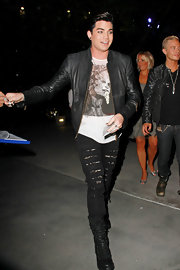 Adam Lambert donned black lace up boots with a pair of ripped black jeans to the Lady Gaga concert.