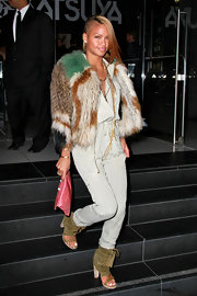 The singer stepped out in a fur coat, skinny jeans and a suede pair of chunky-heeled cut out ankle boots.
