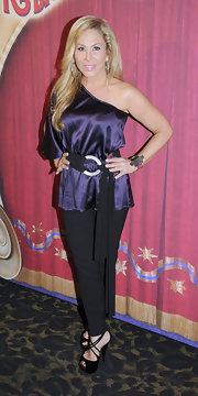 Adrienne Maloof watched the Circus looking sexy in her one-shoulder blouse and black strappy sandals.