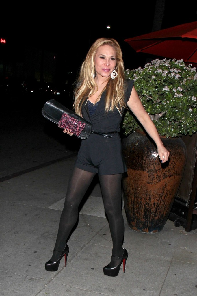 Adrienne Maloof showed off her fit body in a tight black romper during a dinner date