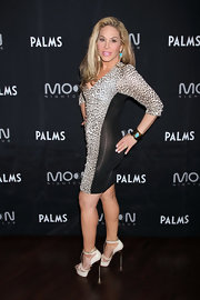 Adrienne Maloof oozed animal appeal in this leopard-print body-con dress during a party in Vegas.