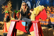 Adrienne Maloof complemented her feminine top with a pair of rough-looking black wedge boots during a visit to Mr. Bones Pumpkin Patch.