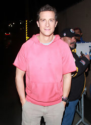 Bear Grylls looked cool and carefree in a salmon hooded shirt.