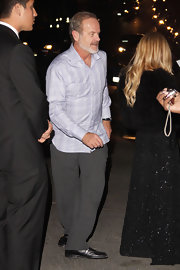 Kelsey Grammer attended the W Magazine Golden Globes party wearing a patterned gray button-down and slacks.