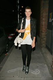Agyness paired her motorcycle jacket and comfy tee shirt with a Tricertops shoulder bag.