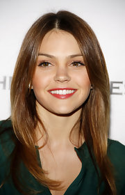 Aimee Teegarden wore a vibrant coral lipstick with a hint of golden sparkle at the LA premiere of 'Beneath the Darkness.'