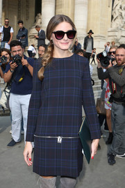 Olivia Palermo rocked a '60s vibe in a navy plaid mini dress during the Carven fashion show.