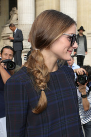 Olivia Palermo wore her hair in a youthful braid when she attended the Carven fashion show.