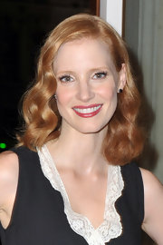 Jessica Chastain's lovely copper waves are an elegant option to an updo. To recreate her look, utilize natural waves or curl one-inch sections of hair with a medium-barreled curling iron. Use fingers to tousle very softly and spritz with a light hold hairspray like Fekkai COIFF Sheer Hold Hairspray.
