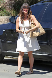 Alanis paired her summer look with a chic pair of aviator shades.