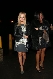 Emma Bunton paired a simple dress with an edgy leather jacket with studs for her evening look while out in London.
