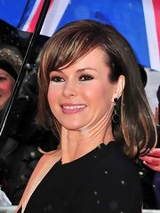 Amanda Holden accessorized with dangling black earrings at auditions in London.