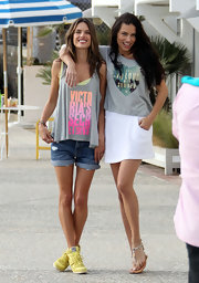 "Adriana Lima sported a t-shirt that read ""I Fell In Love With Summer' while posing for a photo shoot in LA."