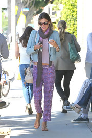 Alessandra Ambrosio went for an on-trend cozy look in these purple print pants.