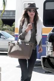 Alessandra dressed up her travel attire with a luxe tan Hermes Birkin with silver hardware.