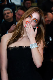 A thick diamond-studded cuff was Barbara Palvin's lone accessory at the premiere of 'All is Lost' at Cannes.