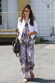 Alessandra Ambrosio kept her maxi light and airy by opting for this white denim jacket.