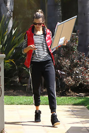 Alessandra Ambrosio chose a red puffer vest to pair over her striped top for a casual daytime look while running errands in LA.