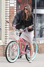 Alessandra Ambrosio posed in a leather jacket while riding a bike at a Victoria's Secret photo shoot.