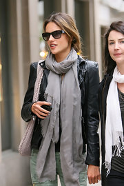 "Alessandra wore the casual-cool black leather ""Cion"" biker jacket with a light gray scarf and colored denim."