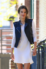 To give some edge to her white frock, Alessandra Ambrosio sported this motorcycle vest.